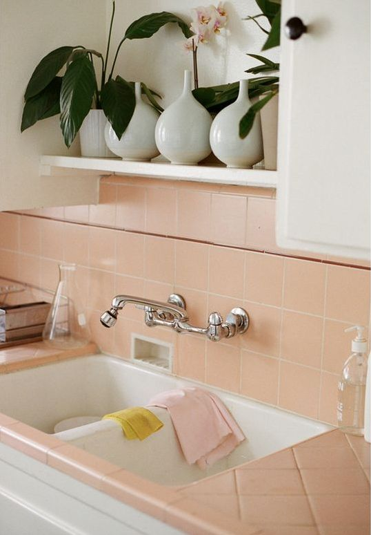 Salmon Pink Tiles On The Backsplash And Countertops