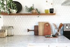 12 marble countertop and small hex tile backsplash