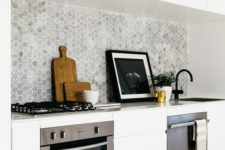 13 marble grey backsplash contrasts with pure white cabinets