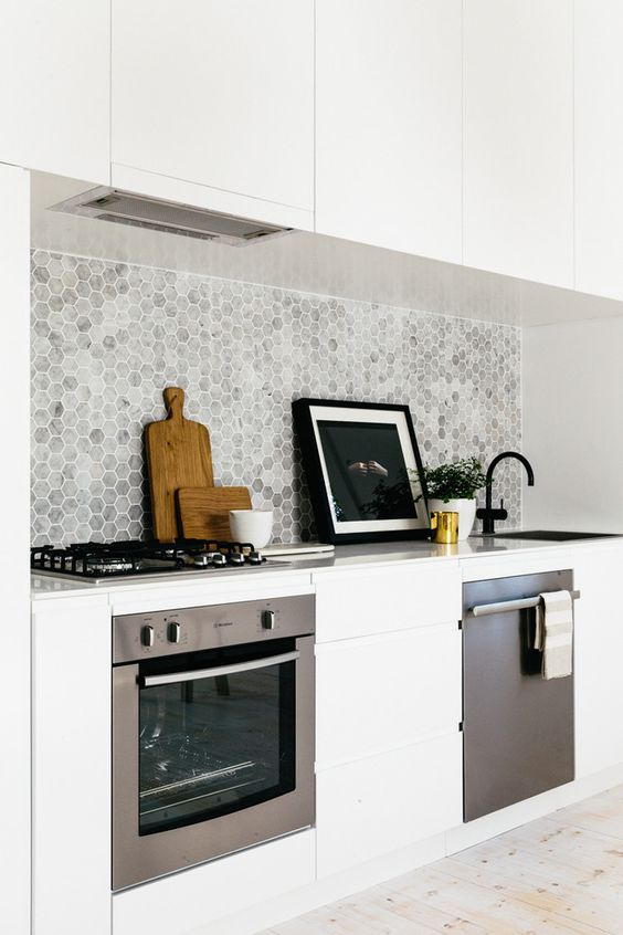 marble grey backsplash contrasts with pure white cabinets