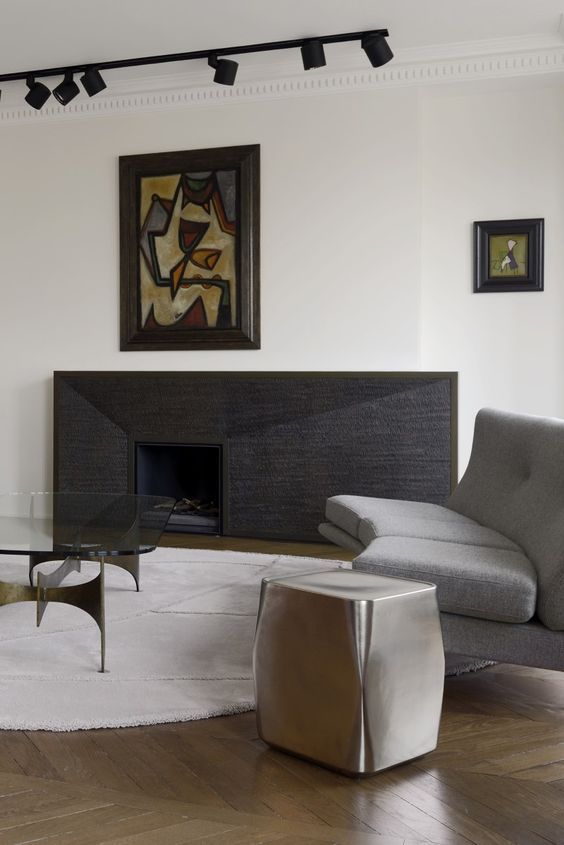 refined modern living room with track lights to accentuate artworks