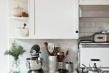 13 white tiles on the countertops and backsplash, white grout