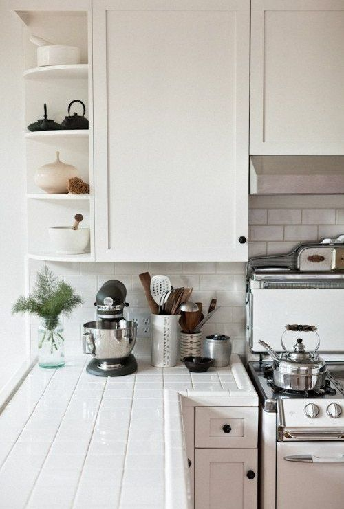 white tiles on the countertops and backsplash, white grout