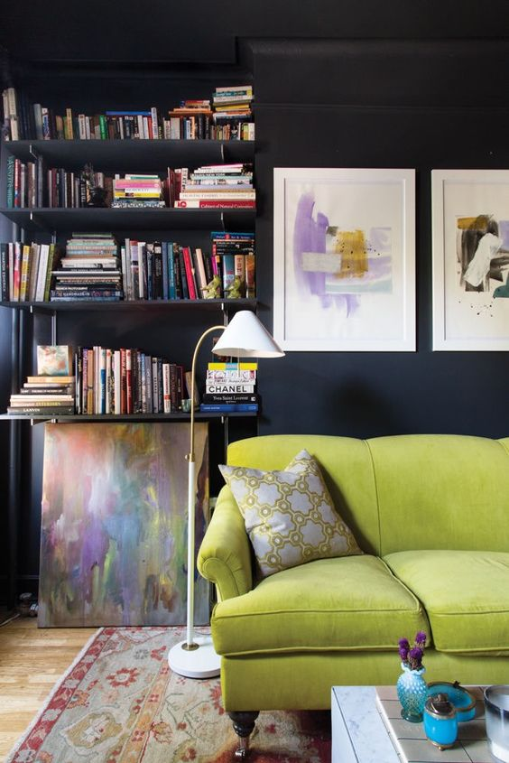 a moody living room with a lime green sofa