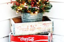 14 a small tree with lights and berries in a glavanized bucket and crates