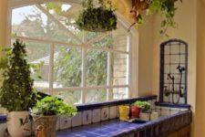 14 beautiful blue tiles on the kitchen island