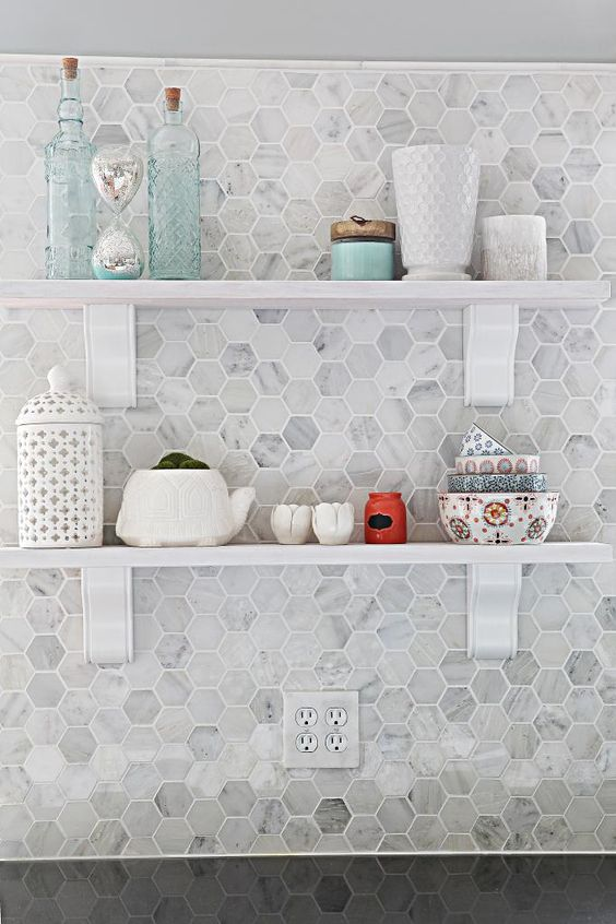 marble hex backsplash with white grout
