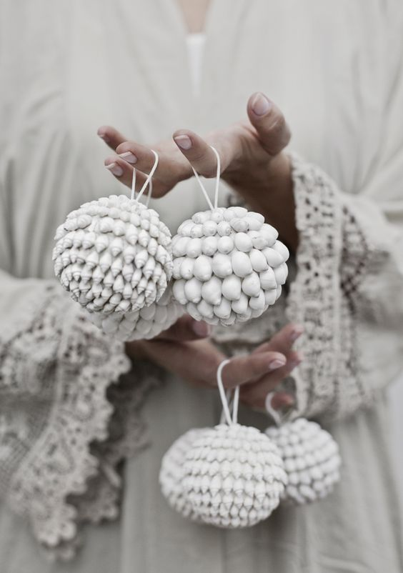 whitewashed shell ornaments look very boho like