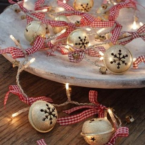 whitewashed tray with jingle bells and string lights