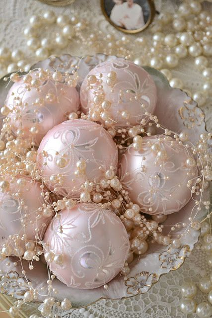 a chic bowl with pearls and pastel pink ornaments is a cool delicate display