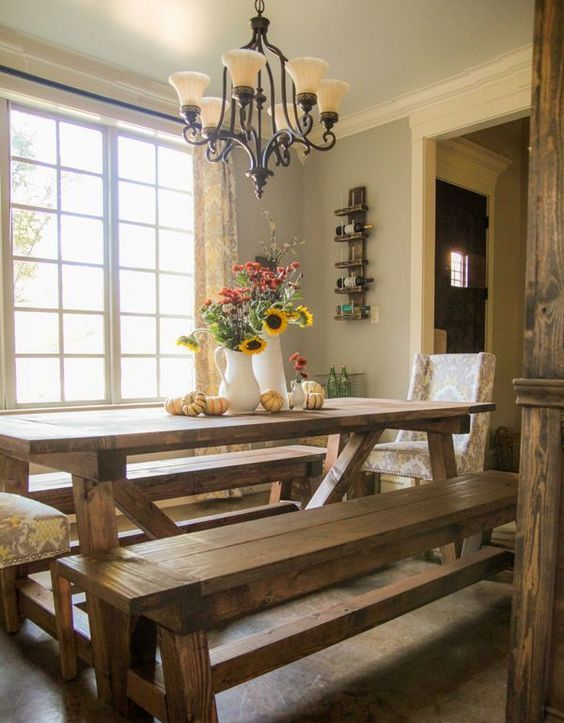 rustic stained wooden table and benches are ideal to add a cozy touch