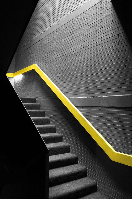 modern neon yellow handrail to contrast with the dark space