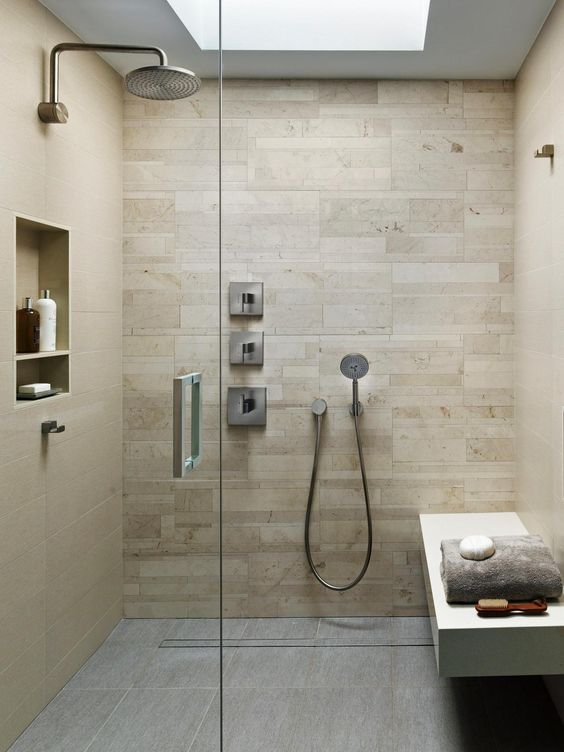 modern warm-colored shower and steam room with a comfy bench