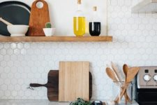 17 marble small hexagon tiles and a marble countertop look harmonious together