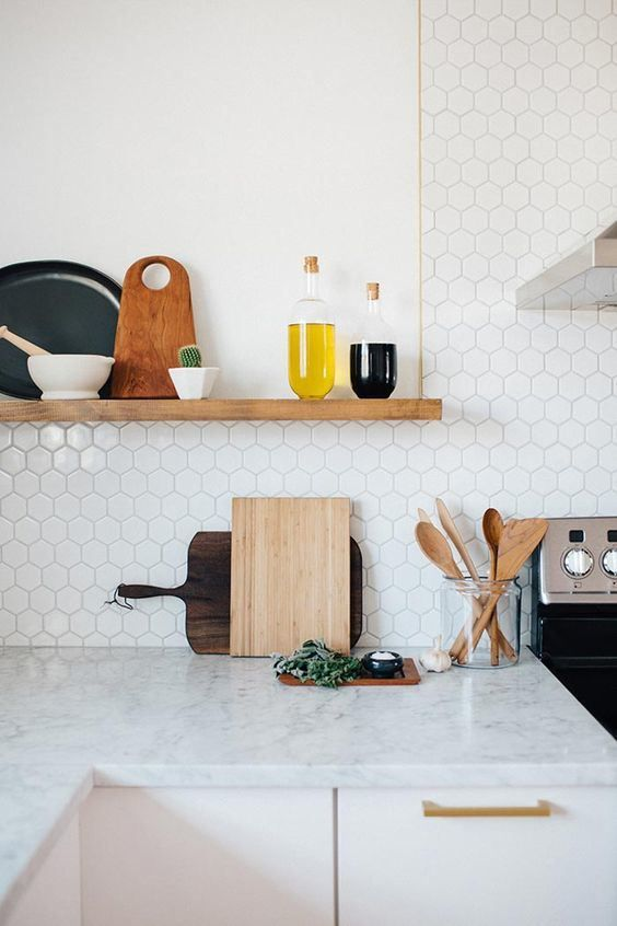 marble small hexagon tiles and a marble countertop look harmonious together