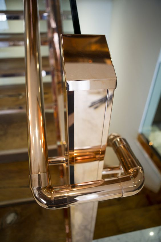 polished copper staircase handrail