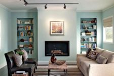 17 track lights accentuate a faux fireplace and artworks