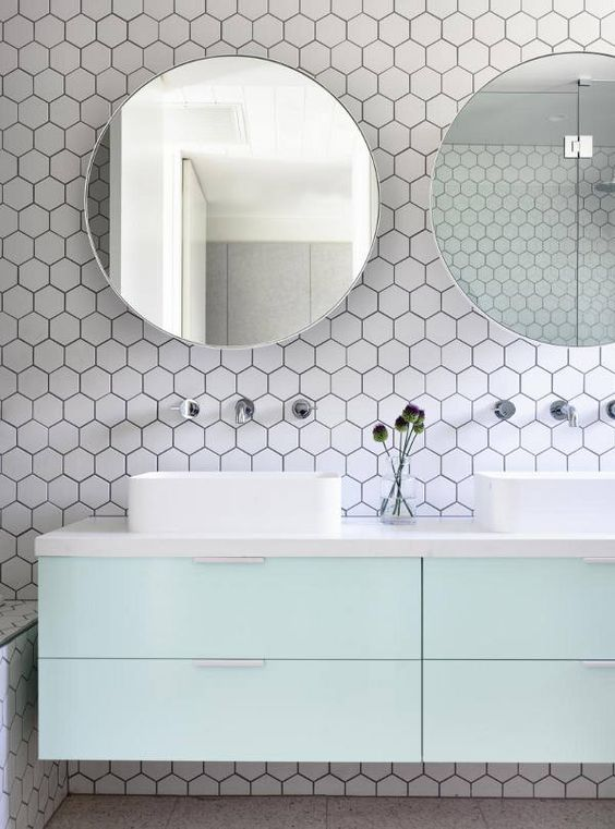white hex tiles with black grout contrast with mint cabinets. 39 Stylish Hexagon Tiles Ideas For Bathrooms   DigsDigs