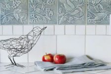 18 different tiles on the backsplash and countertop, light blue pattern tile accent
