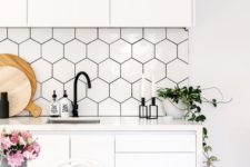 18 white hex tile backsplash with black grout to fit the decor