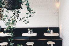 18 whitewashed brick clad, a black sofa and white furniture create a clean modern look