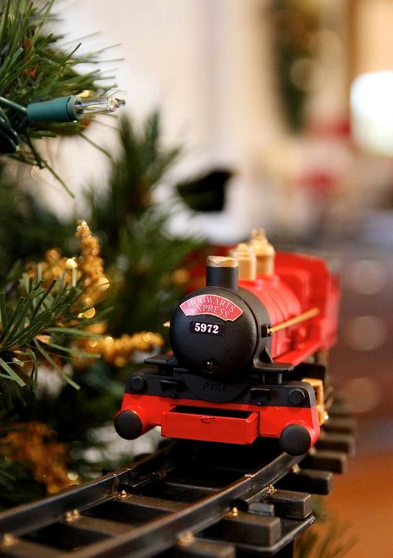 Hogwarts Express train placed at the bottom of the tree