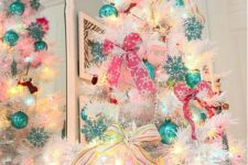 19 colorful pink and turquoise ornaments and lights
