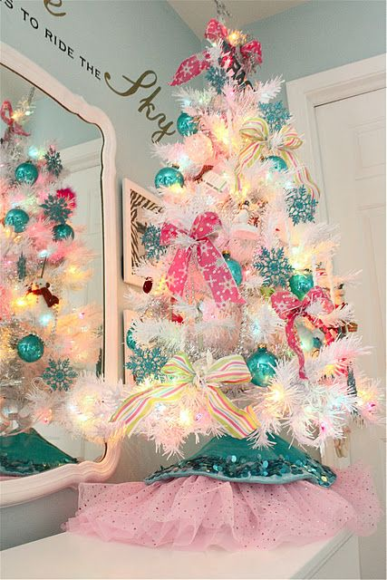 colorful pink and turquoise ornaments and lights