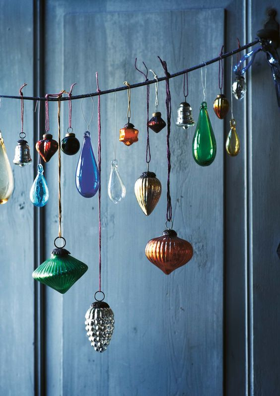 even if you don't have a tree, you can still display bold vintage ornaments in a beautiful way