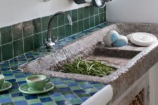 19 green and blue tiles on the backsplash and countertop