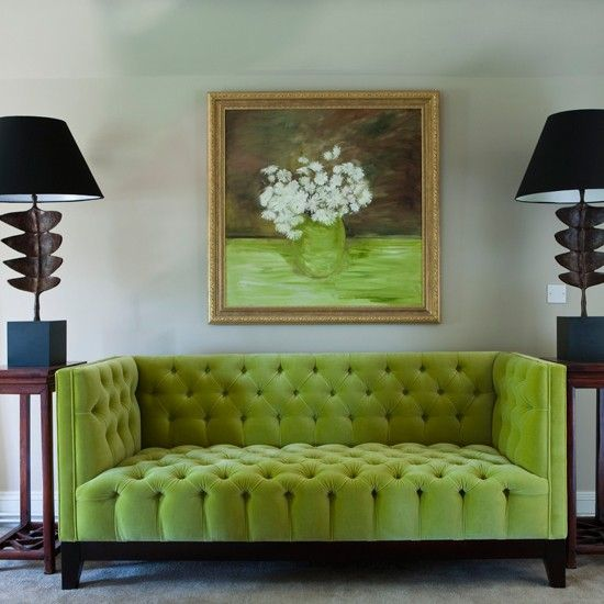upholstered lime sofa contrasts with black lamps