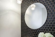 20 small black hex tiles on the bathroom wall with white grout