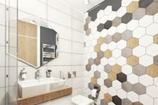 21 hex tiles mosaics on the wall and wooden floors make the bathroom hoht