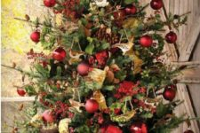 21 lush tree in a box with red ornaments, gold and green deco mesh and garlands