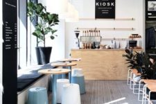 21 modern coffee shop with whitewashed floors, black accents and pastel touches