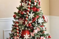 21 red and white Christmas tree with oversized balls and candy canes