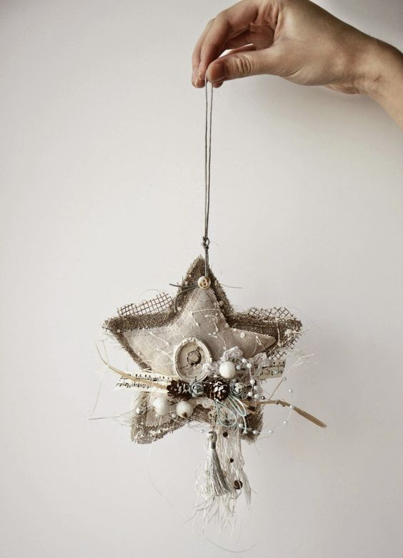 shabby chic star-shaped ornament with pinecones and beads