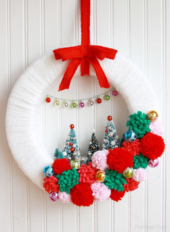 winter wonderland Christmas wreath with pompoms and bottle brush trees