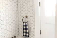 22 white hexagonal tiles with black grout and black cabinets