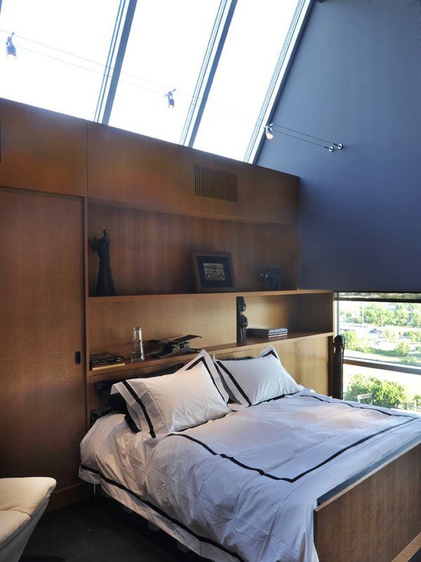 Attic Bedroom With Track Lights Hanging Over The Bed