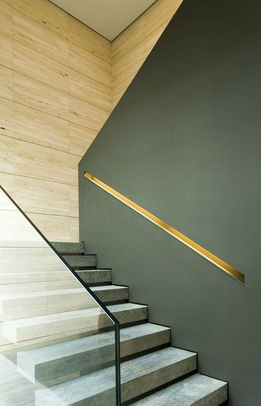 handrail cut out in the wall and decorated with a metal shade