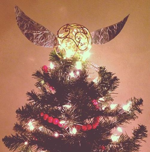 lit up Golden Snitch Christmas tree topper