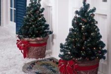 23 mini potted trees with lights and large red bows