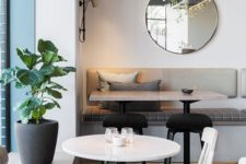 23 neutral modern decor, round tables and potted plants