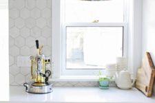 23 stylish marble hex tile on the kitchen floor