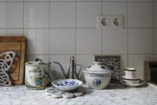 23 usual white tiles on the backsplash and hexagon penny tiles on the countertop