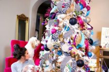 23 whimsy tree made of deco mesh and ornaments of all colors