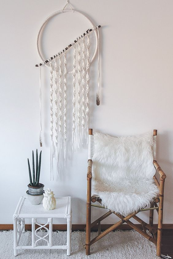 a macrame dreamcatcher wreath and fur cover
