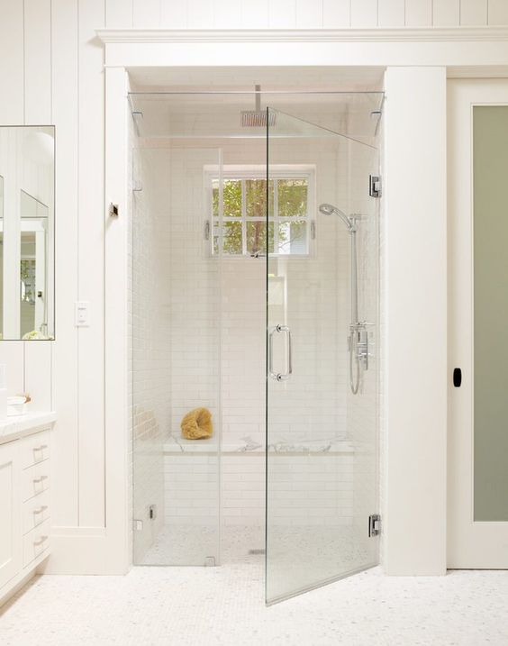 all-white bathroom and steam room with a shower