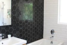 24 black honeycomb tiles on the wall